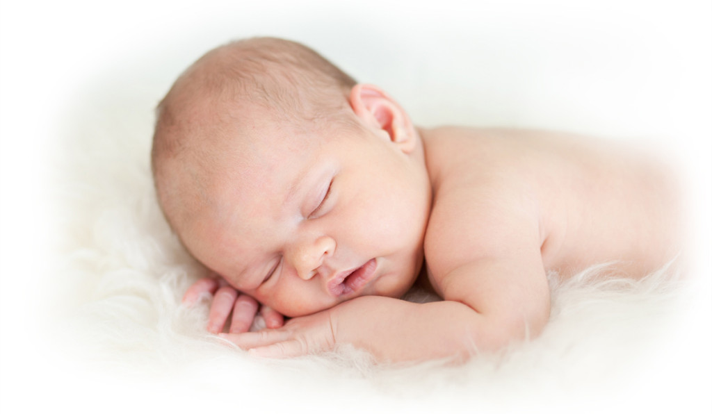3800650-newborn-baby-girl-sleeping-on-her-stomach